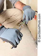 Electrician clipping wire