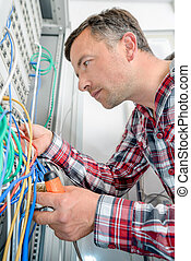 Electrician connecting cables