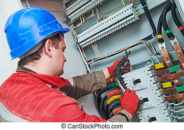 Electrician connecting power cable