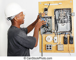 Electrician Crimping Wire - Electrician crimping a wire in ...