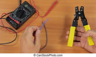 Electrician cuts the wires with a pliers. Electrician...