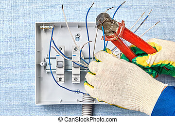 Electrician cutting ends of copper electric wires.