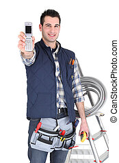 Electrician displaying mobile telephone