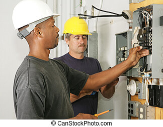 Electrician Diversity - An african american and a caucasian...
