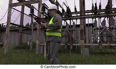 Electrician engineer checkout documentation at substation