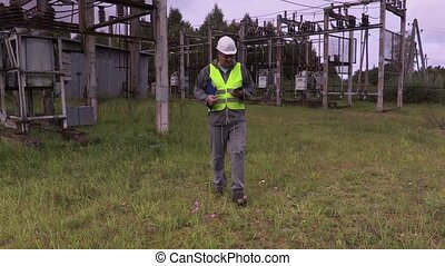 Electrician engineer gives the task to cut the grass in...