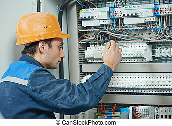 electrician engineer worker - Young adult electrician...