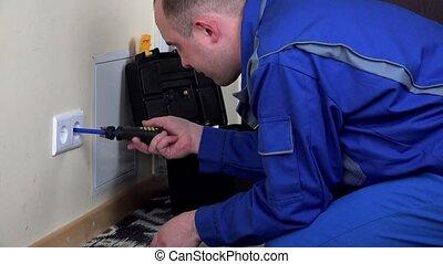electrician guy install wall power socket