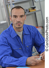 Electrician holding a fuse