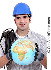 Electrician holding a globe.