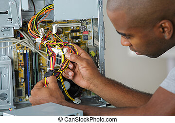 Electrician holding cables