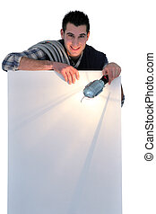 Electrician holding lamp