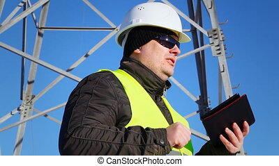Electrician inspect electric lines