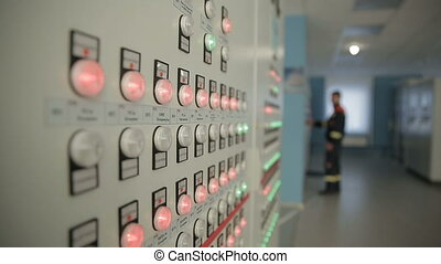 Electrician inspect equipment at the substation -...