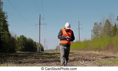 Electrician inspect the high-voltage power lines technical...