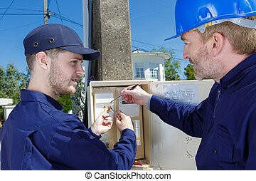 electrician inspecting the fuse box