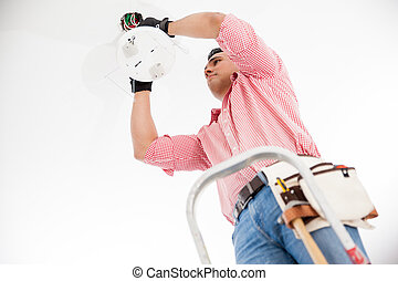 Electrician installing a lamp