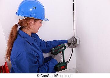 Electrician installing a wall socket