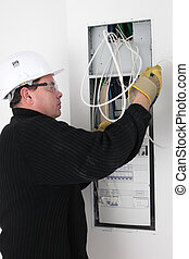 Electrician installing electric meter