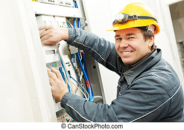 Electrician installing energy saving meter - One electrician...