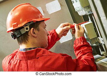 Electrician installing or repairing energy saving meter. Maintenance service