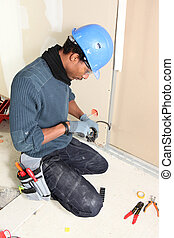 Electrician installing wiring system