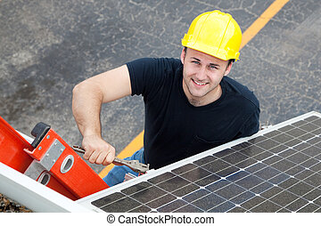 Electrician Installs Solar Panel - Young electrician on a...