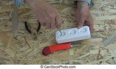 Electrician  looking  white socket