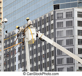 electrician maintenance high voltage electric wire pole