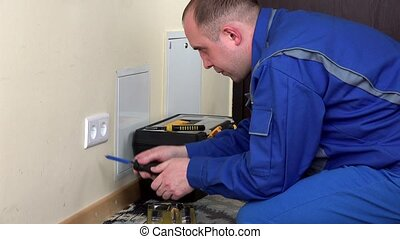 electrician man install wall power socket