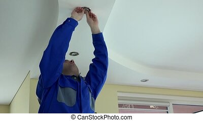 electrician man take out and check halogen lamp bulb