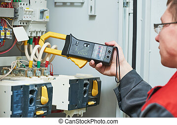 electrician measurements with multimeter tester