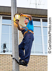 electrician on a pole