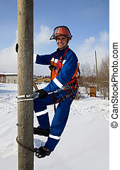 Electrician on a pole in a good mood