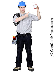 electrician pointing at the object he is holding