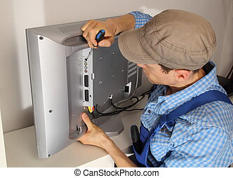 Electrician repairing a TV