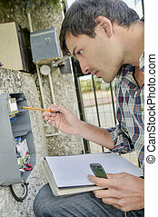 Electrician repairing electrical panel
