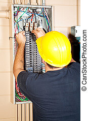 Electrician Replaces Breaker - Electrician replacing a bad...