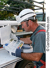 Electrician & Servic - An electrician looking through his ...
