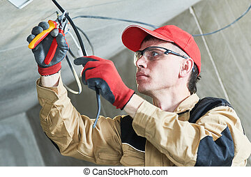 electrician service. Installer works with cable