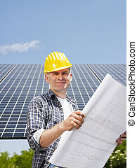 electrician standing near solar panels - Portrait of mid ...