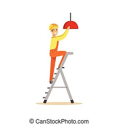 Electrician standing on a stepladder installing lighting on...