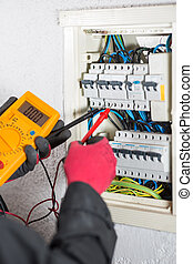 Electrician performing checks on a light box