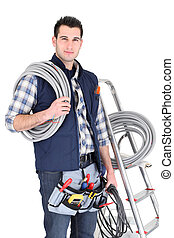 Electrician stood by ladder with his equipment