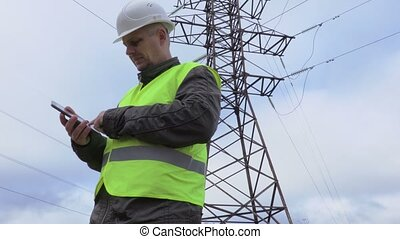 Electrician take pictures near high voltage line