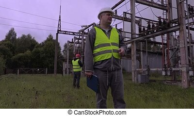 Electrician talking in substation
