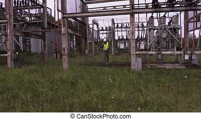 Electrician talking on phone and walking in electrical...