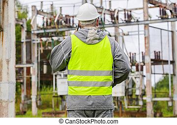 Electrician talking on the phone