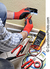 Electrician technician at work with safety equipment on a residential electrical system