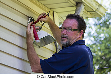 Electrician Testing A Outside Light